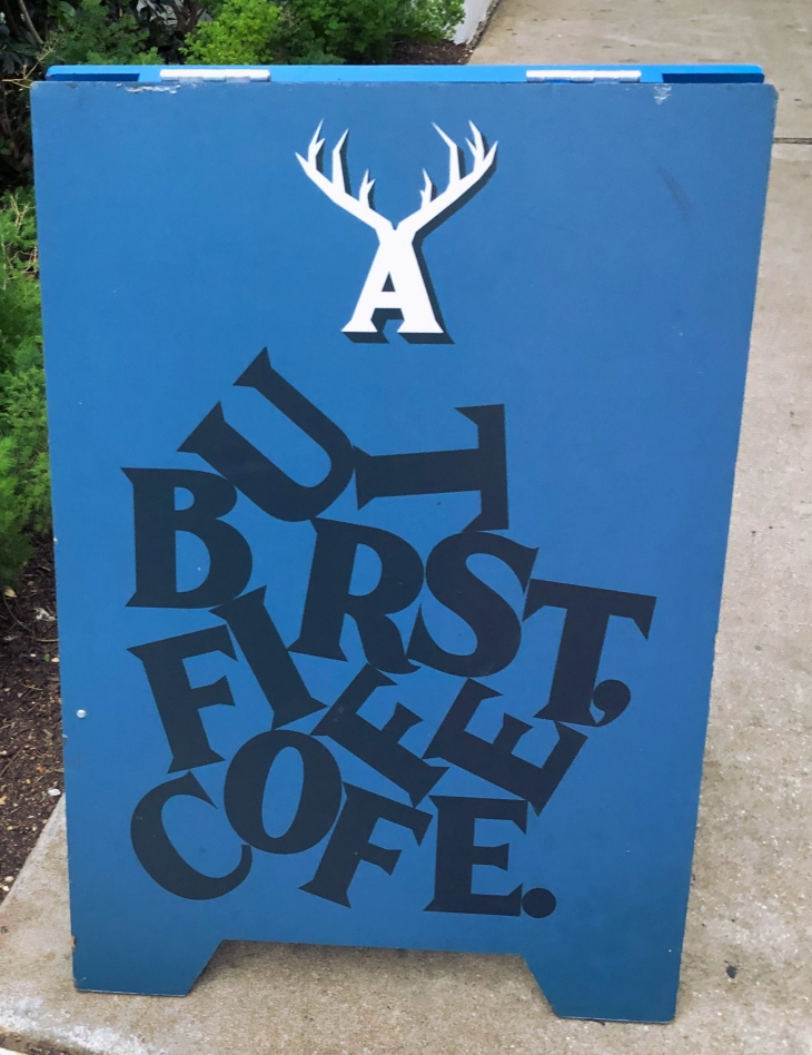 A coffee shop signboard on the streets of Austin