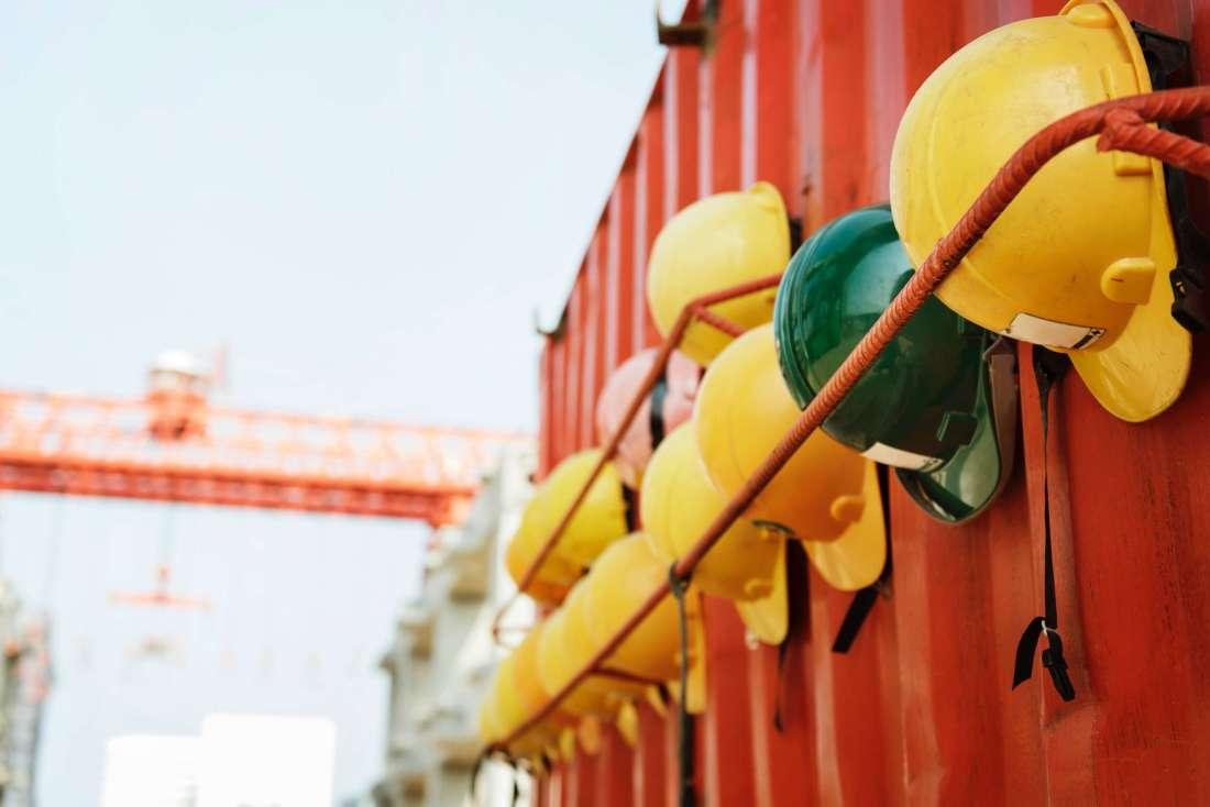 Yellow hats at a construction site - Unsplash.com