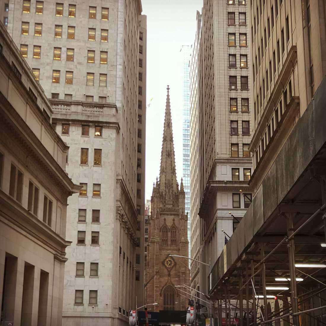 Trinity Church as seen from near the Stock Exchange in Wall StreetTrinity Church as seen from near the Stock Exchange in Wall Street