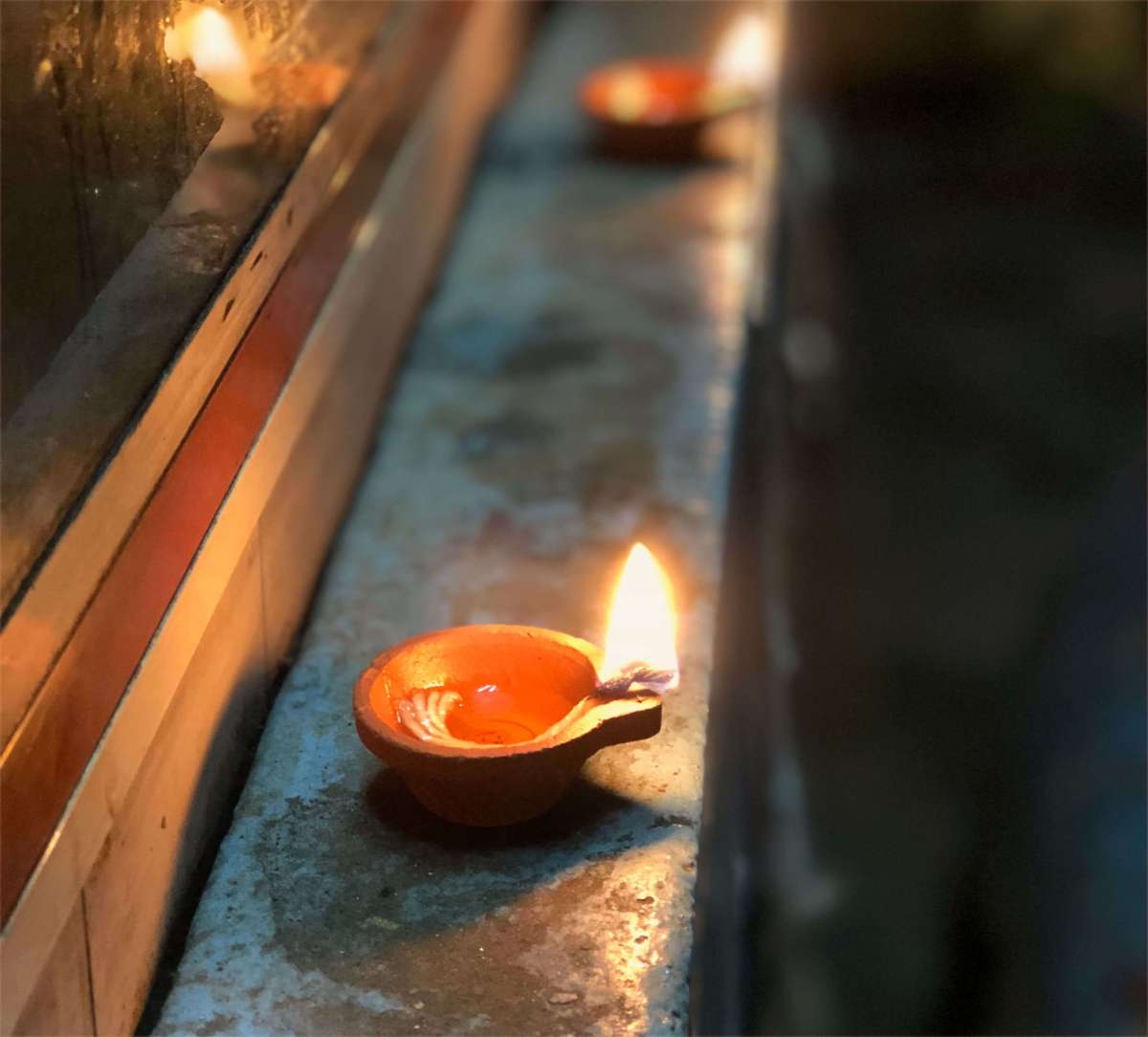 A flame in a clay lamp