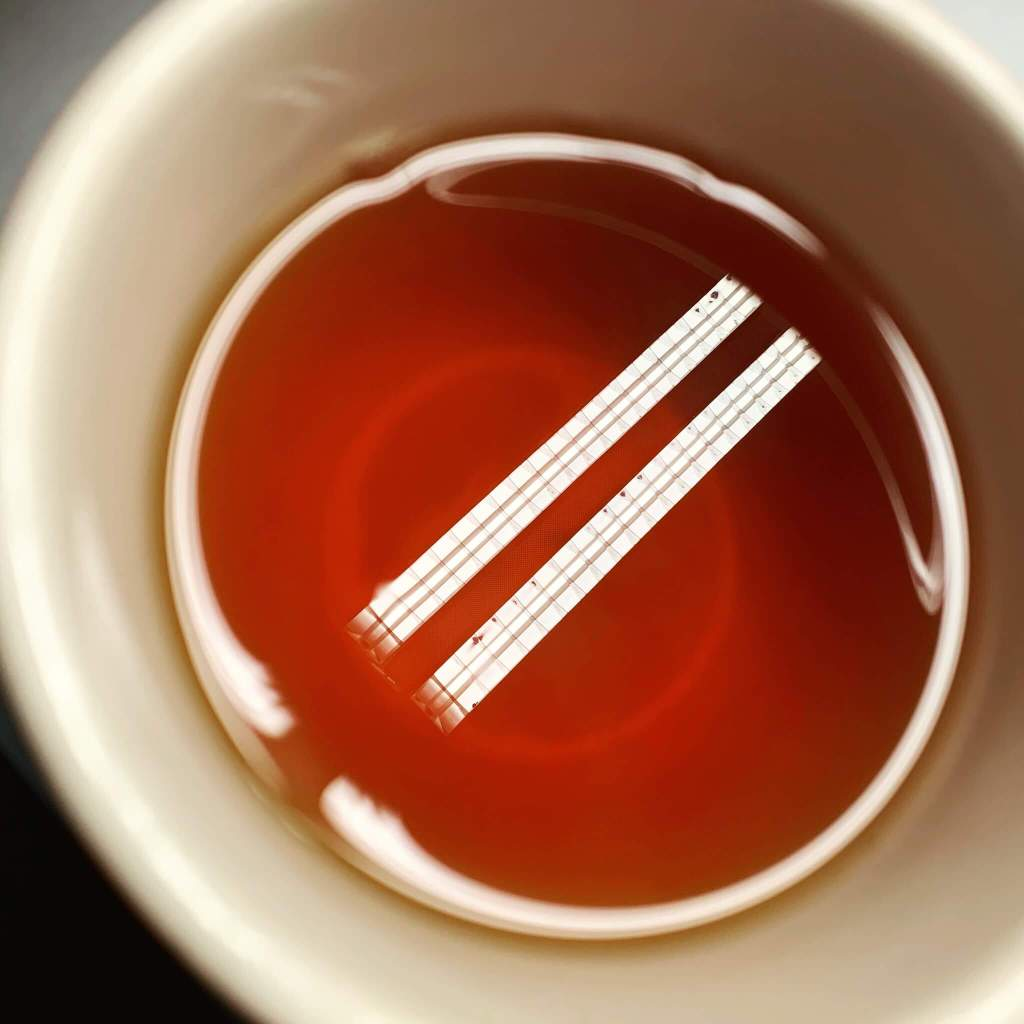 Ceiling lights reflecting on black tea