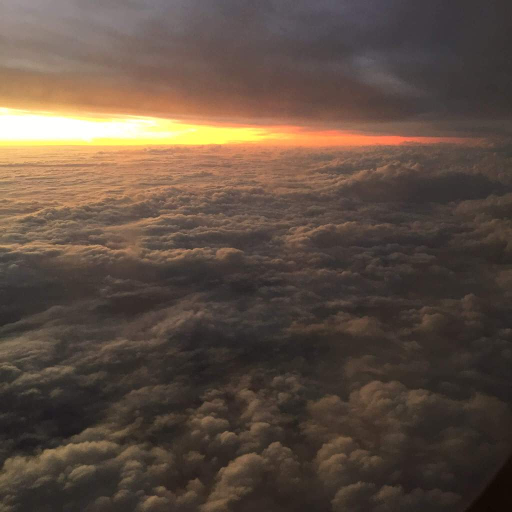 Sunrise above the clouds - as seem from inside an airplane