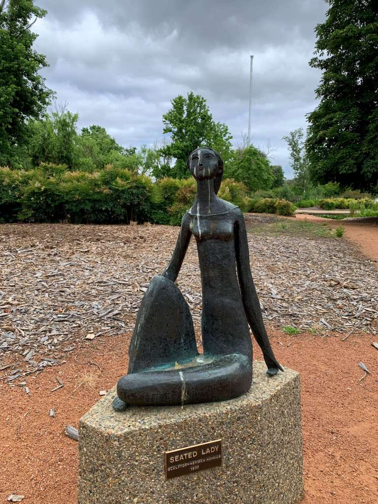 Statue of a seated lady at the Lake Burley Griffin, Canberra