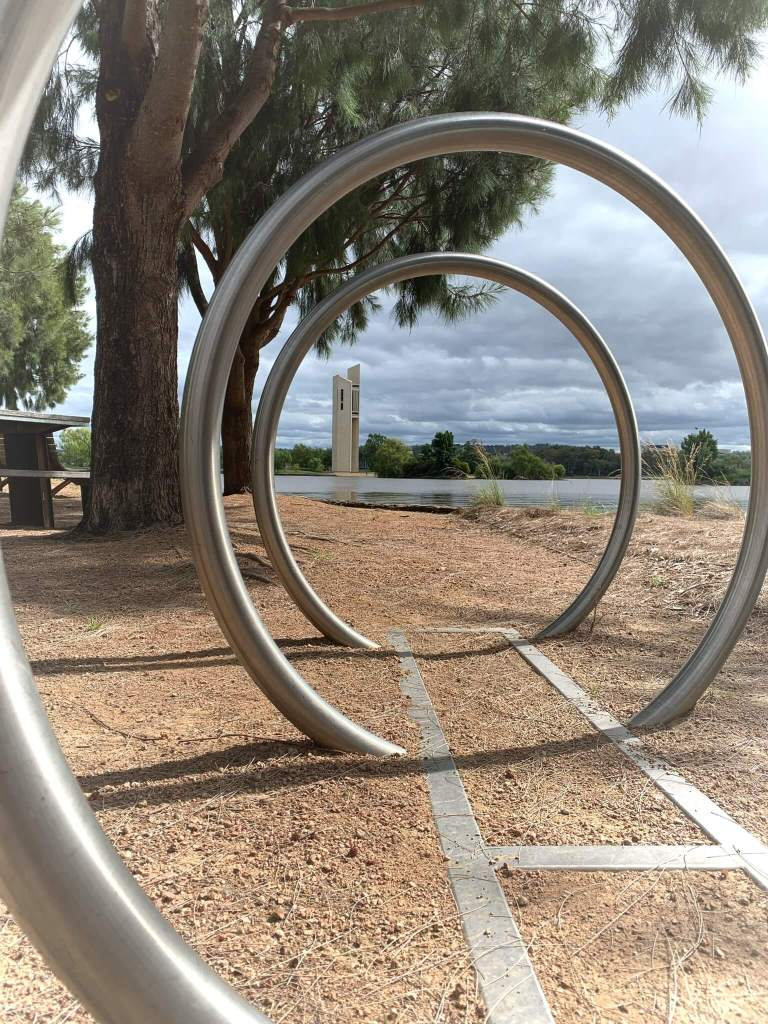 The National Carillon, as seen through bicycle parking stands, Canberra