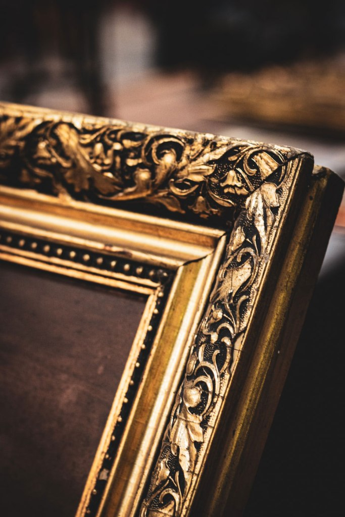 a golden picture frame - Unsplash