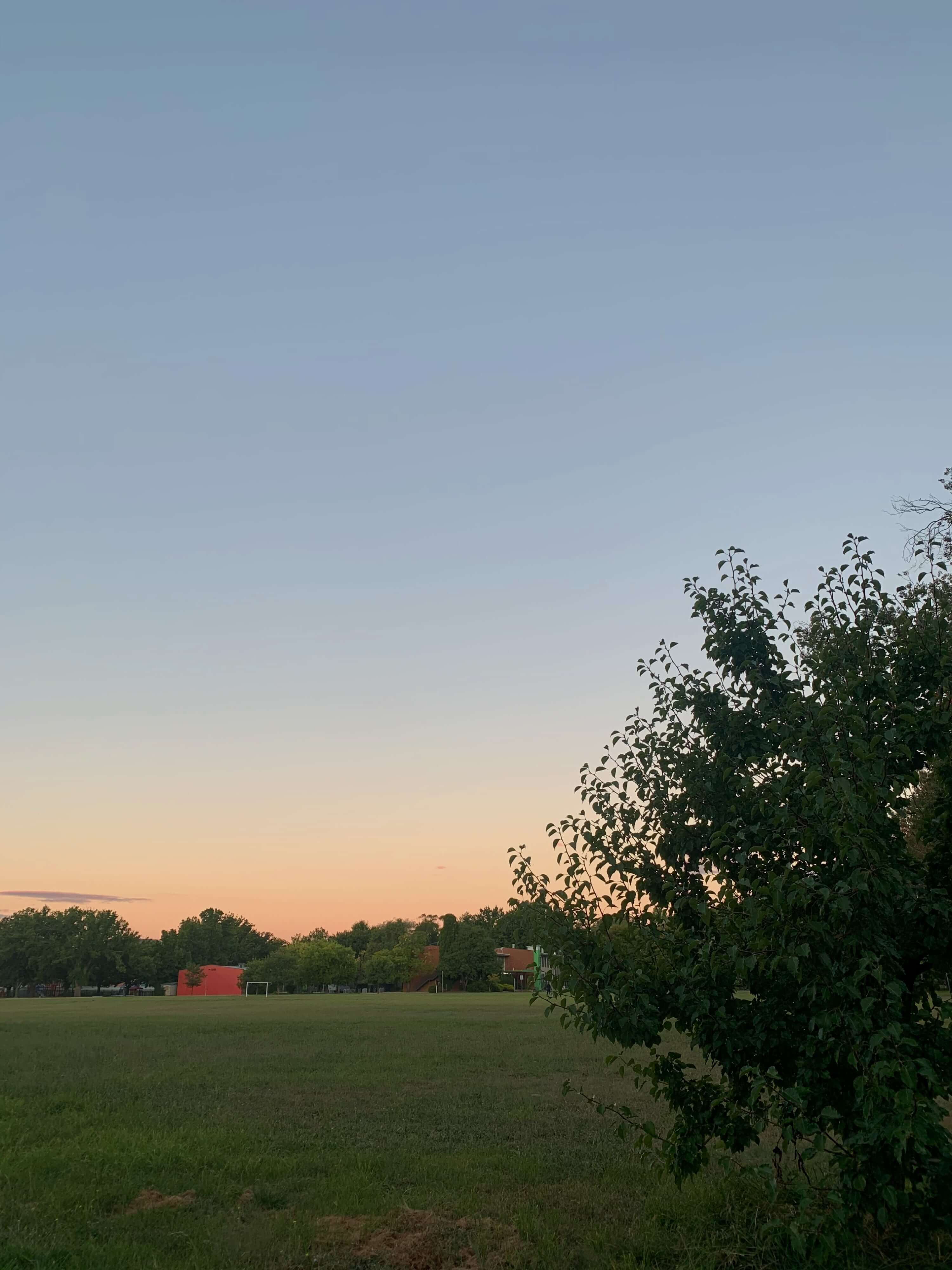 sunset on the horizon, as seem from across a play ground, Canberra