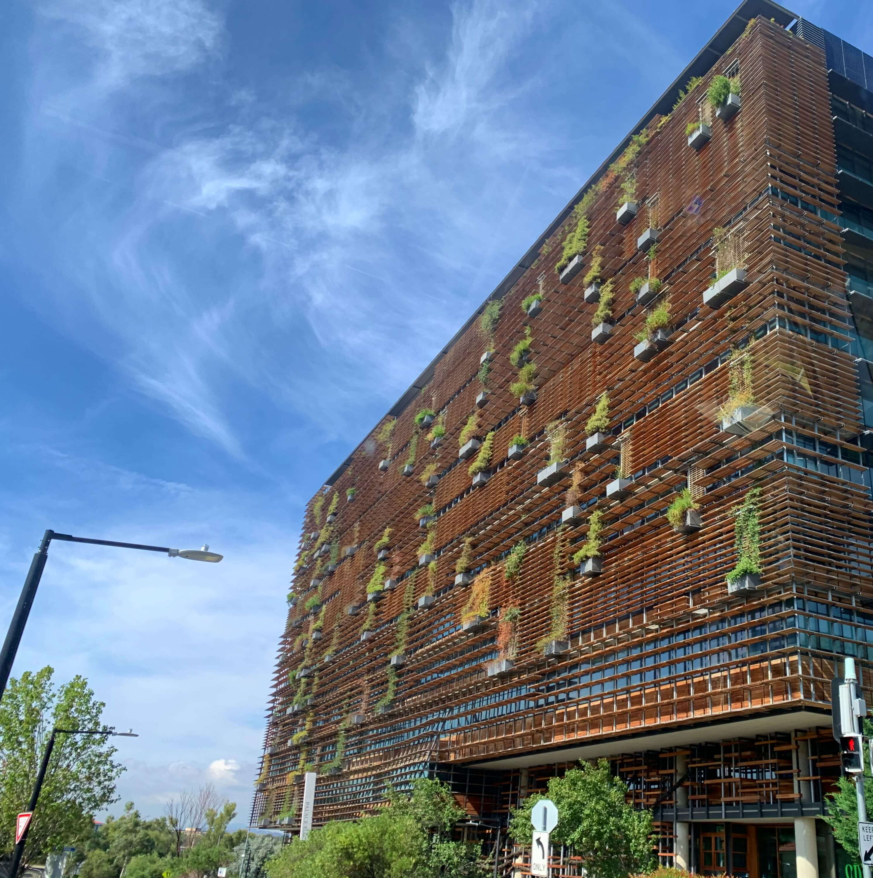 The Ovolo Nishi hotel in Canberra - plants growing on its facade - a conscious architectural design