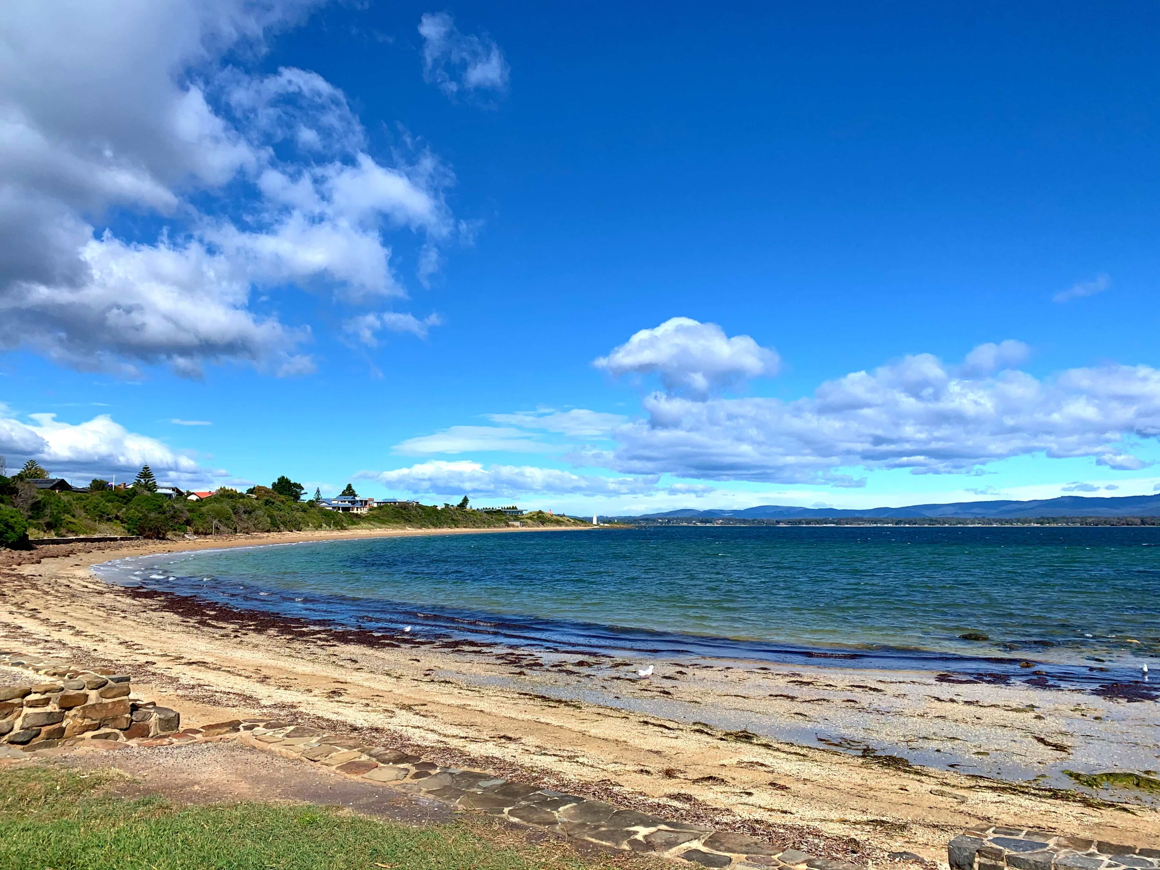 various shades of blue on the sea shore, George Town, Tasmania