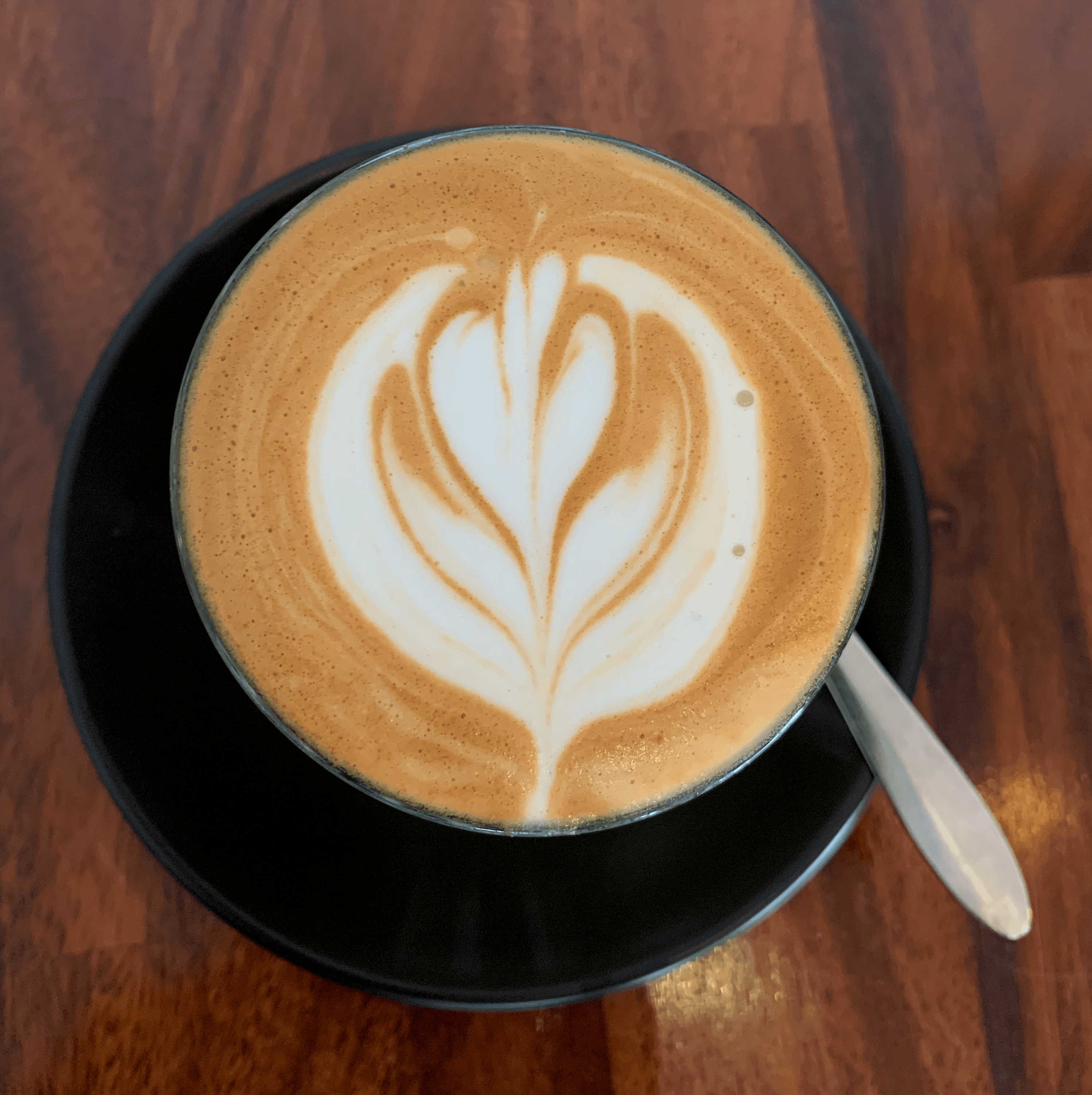 closeup photo of a cup of coffee with latte art