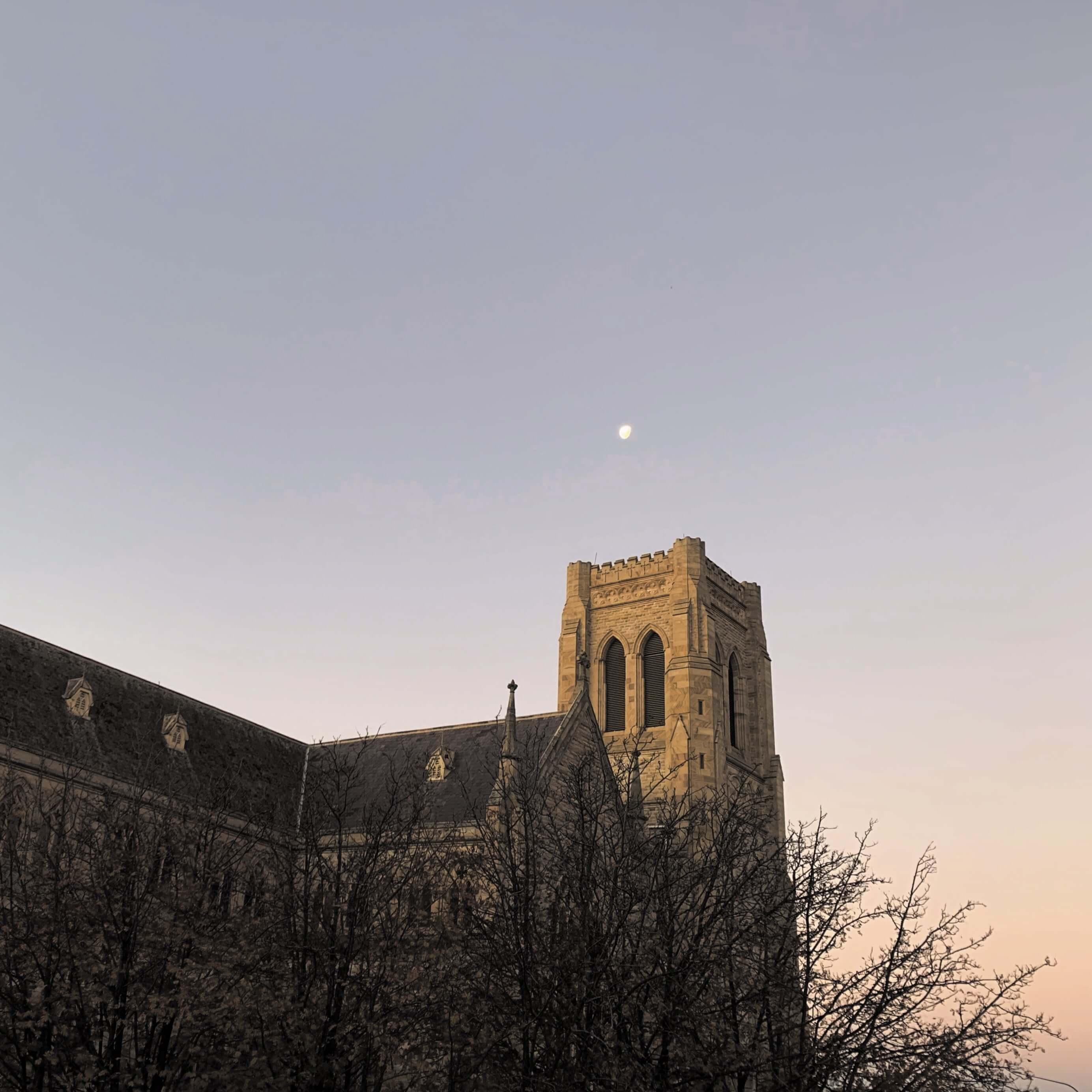 moon as seen over an old church
